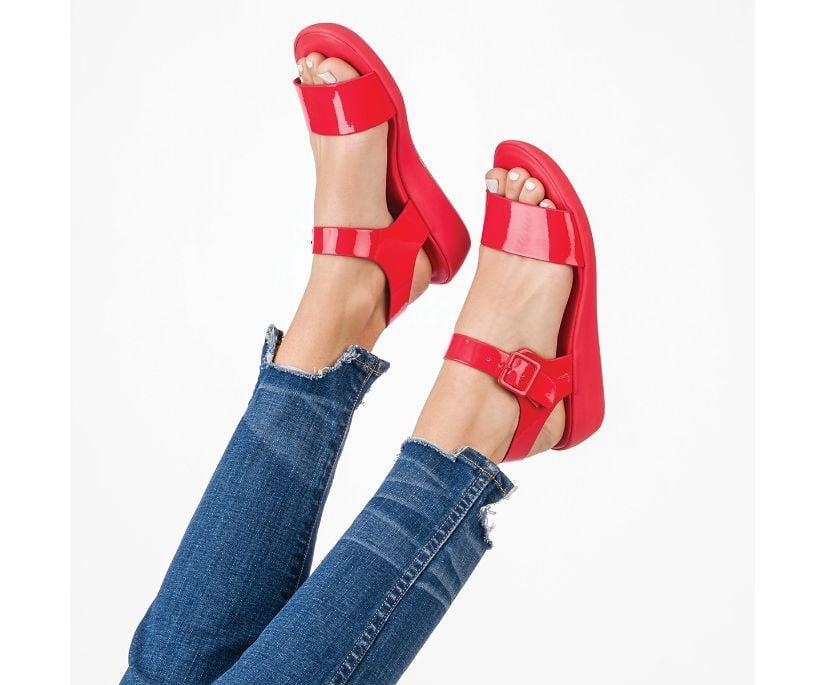 """<p>""""I've been on the hunt for a sandal that is as comfortable as it is stylish and I found it in <span>Hush Puppies Women's Brite Jells Quarter Strap Sandal</span> (on sale for $60.) These jelly sandals bring back major memories from the '90s. When I first received a sample of these shoes to test out, I was thrilled at how cloud like they felt when walking. I'm currently pregnant, so walking is my favorite form of exercise these days. The built-in Bounce™ technology that provides energy return with every step making them my go-to on days when I'm going on a longer walk."""" - GFR</p>"""
