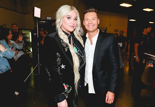 <p>LAS VEGAS, NV – SEPTEMBER 23: Kesha and Ryan Seacrest attend the 2017 iHeartRadio Music Festival at T-Mobile Arena on September 23, 2017 in Las Vegas, Nevada. (Photo: Getty Images for iHeartRadio) </p>