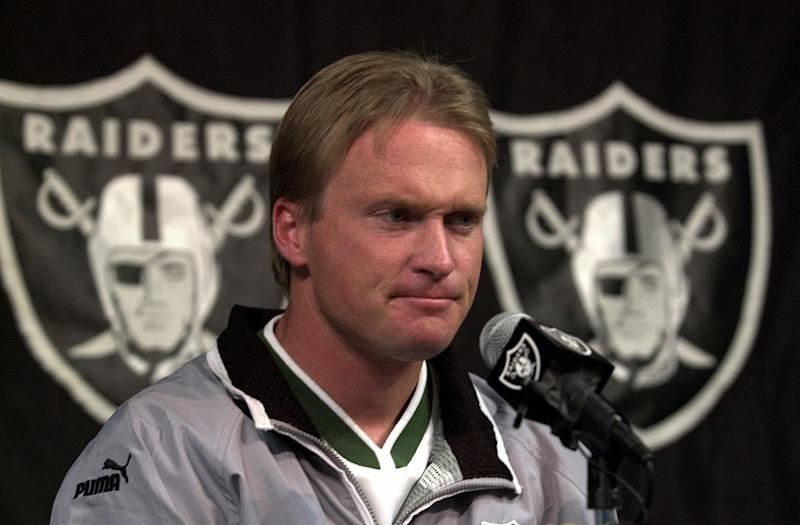 Jon Gruden, at a press conference in 2001, has reportedly agreed to come back to coach the Raiders. (AP)