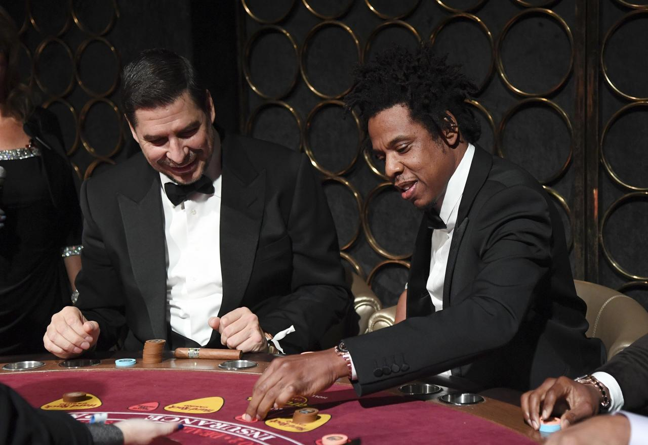"""Ante up! <a href=""""http://ew.com/tag/jay-z"""">Jay-Z</a>, pictured here with tech executiveMarcelo Claure, hit the tables during the Shawn Carter Foundation Gala at the Seminole Hard Rock Hotel & Casino in Hollywood, Fla."""