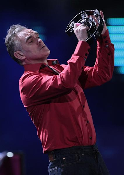 "FILE - In this Friday, Feb. 24, 2012 file photo, England's singer Morrissey performs at the 53rd annual Vina del Mar International Song Festival in Vina del Mar, Chile. Animal rights activist and singer Morrissey said he's canceled an appearance Tuesday, Feb. 26, 2013, on Jimmy Kimmel's talk show because cast members of A&E's ""Duck Dynasty"" also were scheduled to appear. (AP Photo/Jorge Saenz, File)"