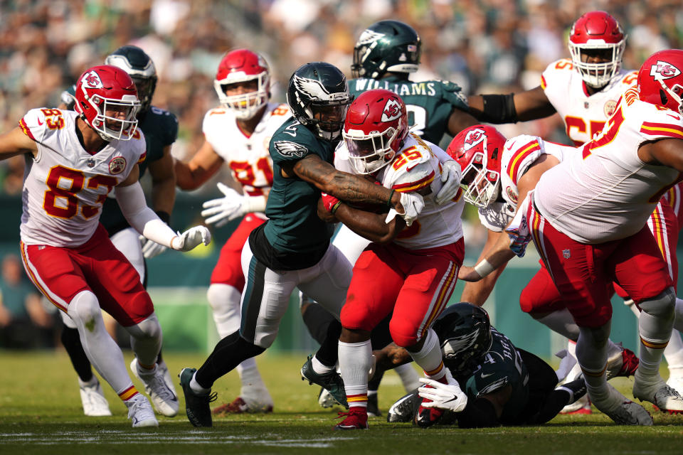 Kansas City Chiefs running back Clyde Edwards-Helaire (25) is tackled by Philadelphia Eagles cornerback Darius Slay (2) during the second half of an NFL football game Sunday, Oct. 3, 2021, in Philadelphia. (AP Photo/Matt Slocum)