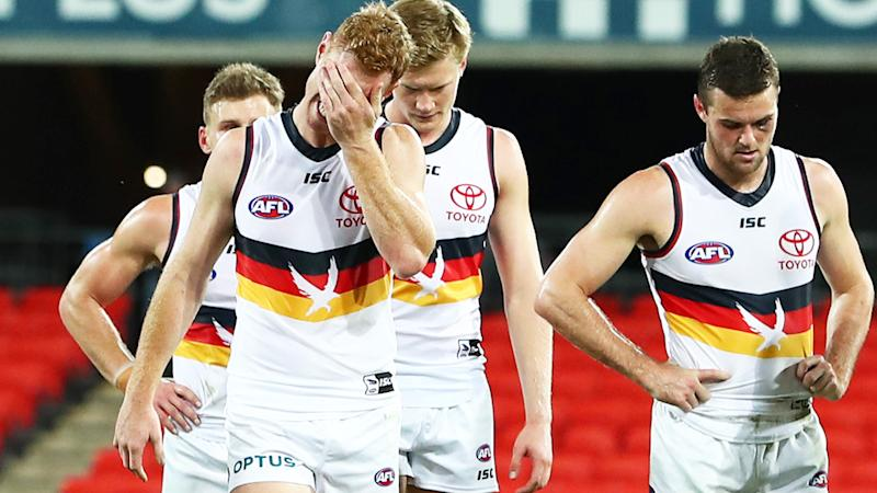 Adelaide Crows players, pictured here after their loss in Round 3 of the AFL.