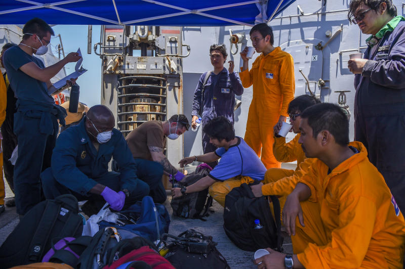 Sailors aboard the Arleigh Burke-class guided-missile destroyer USS Bainbridge render aid to the crew of the M/V Kokuka Courageous on June 13, 2019. | Mass Communication Specialist 3rd Class Jason Waite—U.S. Navy