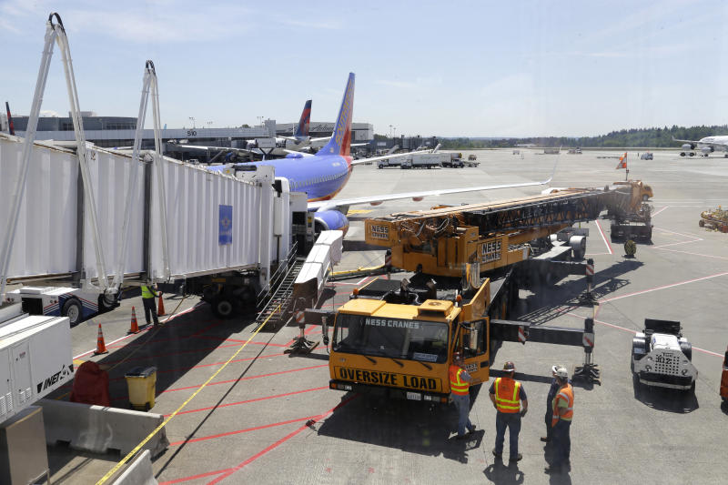 Seattle airport jetway drops as people exit flight