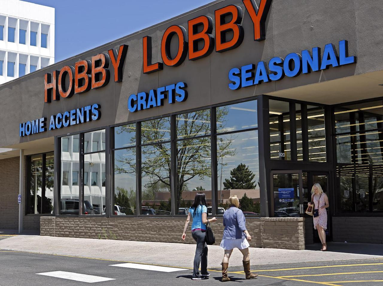 FILE - This May 22, 2013 file photo shows customer at a Hobby Lobby store in Denver. The Supreme Court has agreed to referee another dispute over President Barack Obama's health care law, whether businesses can use religious objections to escape a requirement to cover birth control for employees. The justices said Tuesday they will take up an issue that has divided the lower courts in the face of roughly 40 lawsuits from for-profit companies asking to be spared from having to cover some or all forms of contraception. The court will consider two cases. One involves Hobby Lobby Inc., an Oklahoma City-based arts and crafts chain with 13,000 full-time employees. Hobby Lobby won in the lower courts. (AP Photo/Ed Andrieski, File)