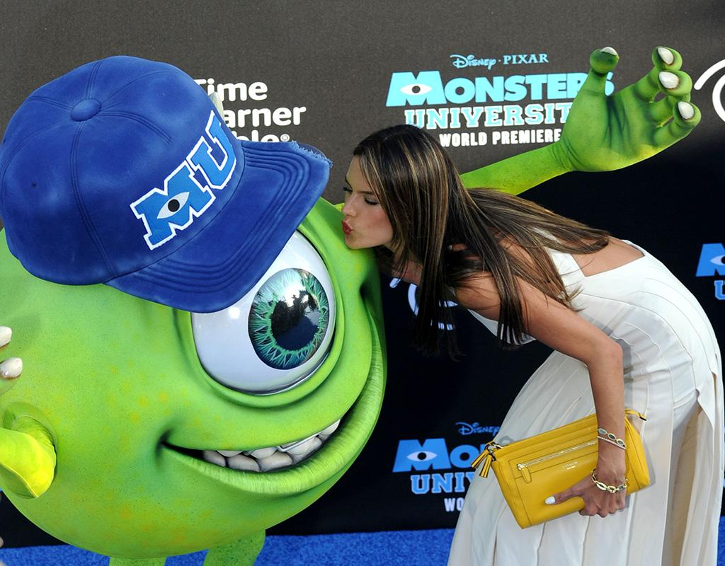 Alessandra Ambrosio kisses monster 'Mike Wazowski' at the Hollywood premiere. The Brazillian supermodel planted a kiss on the loveable monster who is the star of the much anticipated 'Monster's University'. Alessandra was seen arriving at the blue carpet event in Hollywood wearing a flowing white dress.