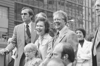 FILE - In this July 10, 1976 file photo Jimmy Carter, his wife Rosalynn and daughter Amy, lower left, respond to a huge crowd that welcomed them to New York. Jimmy Carter and his wife Rosalynn celebrate their 75th anniversary this week on Thursday, July 7, 2021. (AP Photo, File)