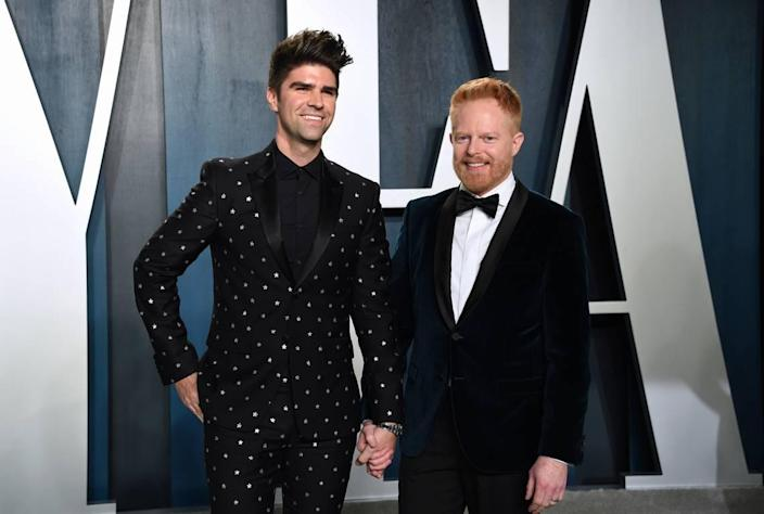 Justin Mikita, left, and Jesse Tyler Ferguson arrive at the Vanity Fair Oscar Party on Sunday, Feb. 9, 2020, in Beverly Hills, Calif. (Photo by Evan Agostini/Invision/AP)