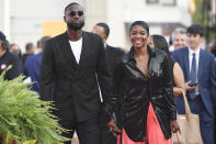 Dwyane Wade and Gabrielle Union walk the red carpet for the 2021 Basketball Hall of Fame Enshrinement ceremony, Saturday, Sept. 11, 2021, in Springfield, Mass. (AP Photo/Jessica Hill)
