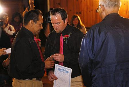 Darren Black Bear and Jason Pickel exchange rings they are married by Darren's father Rev. Floyd Black Bear in El Reno