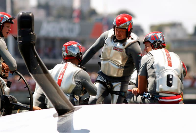 FILE PHOTO: Italy's Luna Rossa Challenge skipper Max Sirena talks with his crew against Emirates Team New Zealand following the seventh race of the Louis Vuitton Cup challenger series yacht race in San Francisco