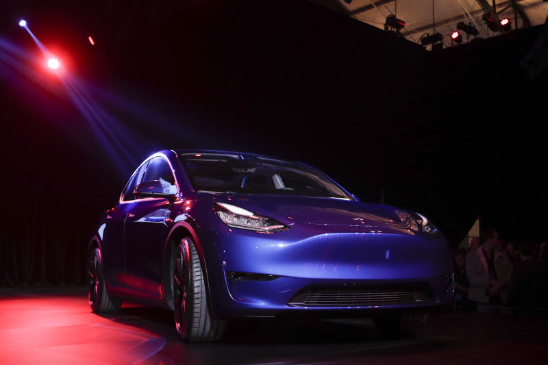 FILE - In this March 14, 2019, file photo the Tesla Model Y is unveiled at Tesla's design studio in Hawthorne, Calif. A Delaware judge is weighing whether to dismiss Tesla shareholders' complaints over a compensation plan that could net CEO Elon Musk more than $50 billion over the next decade. (AP Photo/Jae C. Hong, File)