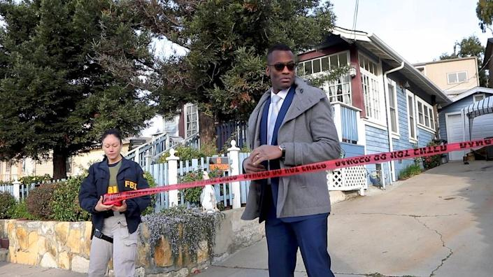 Representatives of the San Luis Obispo County Sheriff's Office and FBI conduct a warrant search of the Flores house in the 500 block of East Branch in February 2020. Sheriff's Office Cmdr. Keith Scott, head of the detective bureau, is on the right.