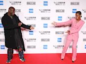 <p>Steve McQueen and Letitia Wright show each other love at the premiere of <em>Mangrove,</em> during the opening night screening of the 64th BFI London Film Festival, on Wednesday in London.</p>
