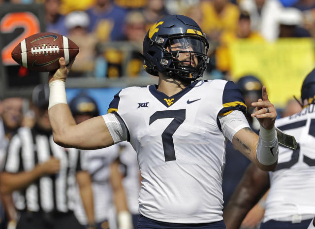FILE - In this Sept. 1, 2018 file photo, West Virginia's Will Grier (7) looks to pass against Tennessee in the first half of an NCAA college football game in Charlotte, N.C. Oklahoma's Kyler Murray, West Virginia's Will Grier, Iowa State's Brock Purdy and Sam Ehlinger of Texas have been impressive and could determine which teams makes it to the Dec. 1 title game in Arlington, Texas. (AP Photo/Chuck Burton, File)
