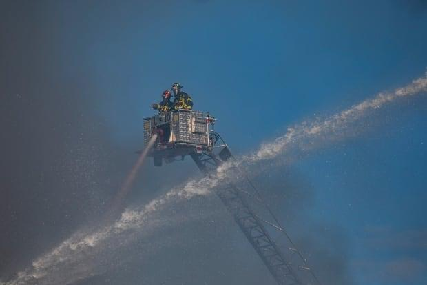 Fire crews work to extinguish a fire at a Masonic Hall on Lonsdale Avenue in North Vancouver on Tuesday.