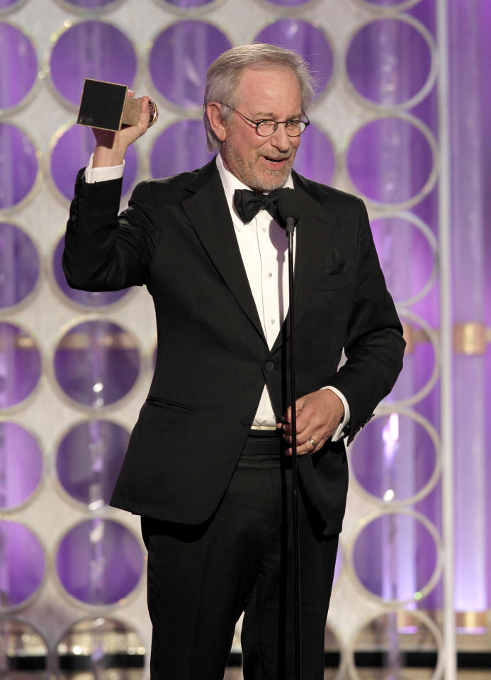 "BEVERLY HILLS, CA - JANUARY 15: In this handout photo provided by NBC, director Steven Spielberg accepts the award for Best Animated Feature Film ""The Adventures of Tintin"" onstage during the 69th Annual Golden Globe Awards at the Beverly Hilton International Ballroom on January 15, 2012 in Beverly Hills, California. (Photo by Paul Drinkwater/NBC via Getty Images)"