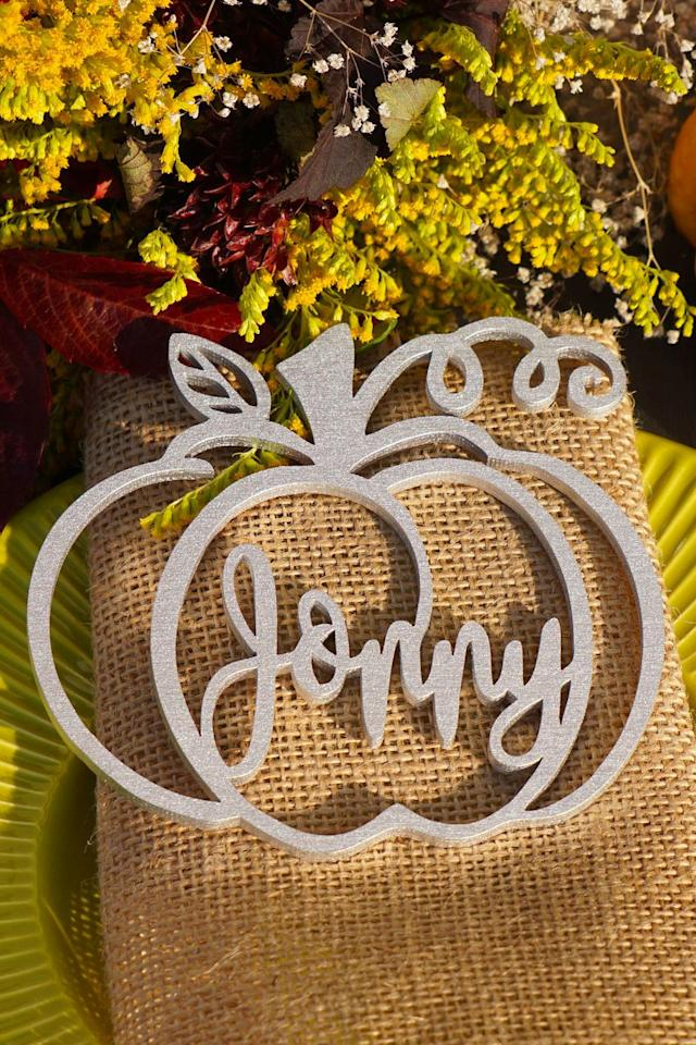 """<p>$16</p><p><a rel=""""nofollow"""" href=""""https://www.etsy.com/listing/563283587/10-thanksgiving-table-decor-thanksgiving"""">SHOP NOW</a></p><p>This cutout pumpkin design isn't just for Thanksgiving, use it for any fall dinner party.</p>"""