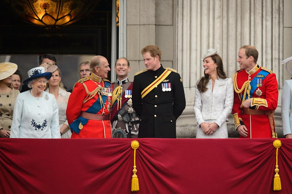 <p>While the Queen looked on, Prince Philip joked around with Harry, Will and Kate while attending the Queen's Birthday Parade in 2014. Photo: Getty Images.</p>