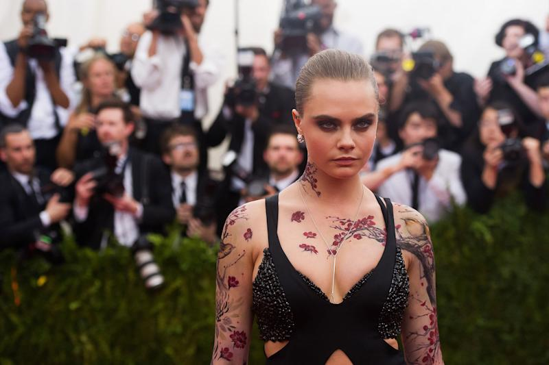 """Cara Delevingne arrives at The Metropolitan Museum of Art's Costume Institute benefit gala celebrating """"China: Through the Looking Glass"""" on Monday, May 4, 2015, in New York. (Photo by Charles Sykes/Invision/AP)"""