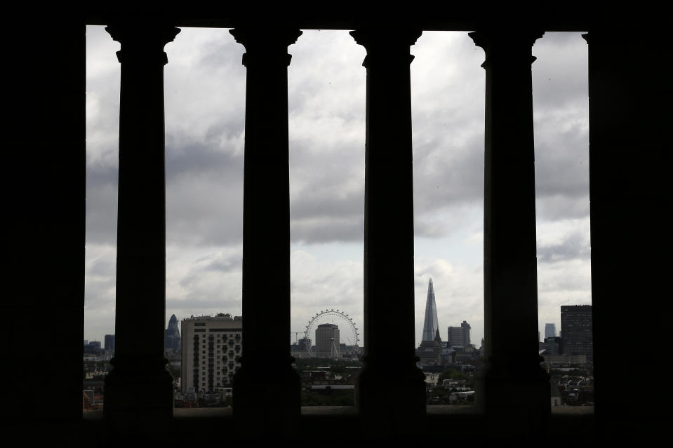 The London Eye and the Shard skyscraper are seen in central London. (Credit: Stefan Wermuth/Reuters)