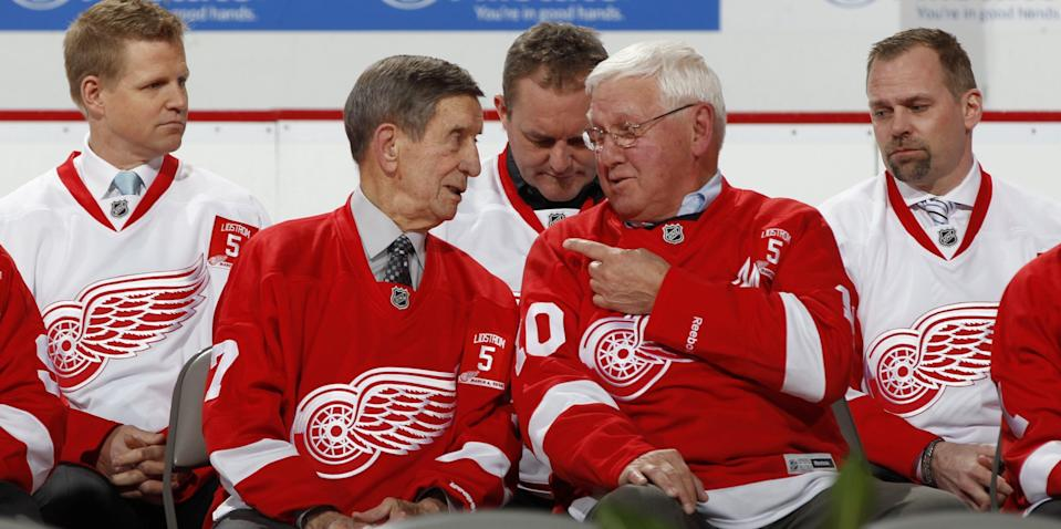 From left: Former Red Wings stars Chris Osgood, Ted Lindsay, Alex Delvecchio, Darren McCarty and Tomas Holmstrom at the retirement ceremony for Nicklas Lidstrom before the Wings game against the Colorado Avalanche on March 6, 2014.