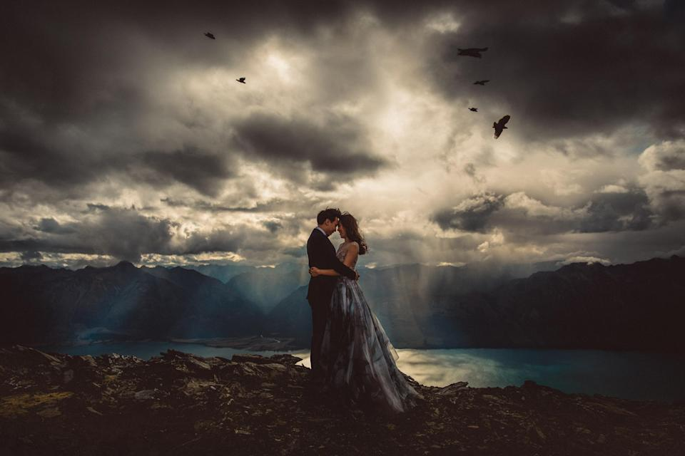 <p>Some were taken from mountaintops and overlooking lakes. (Photo: Junebug Weddings/Caters News) </p>