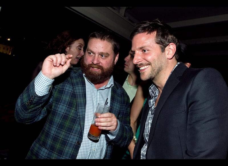Zach Galifianakis (L) talks with Bradley Cooper at the New Yorker White House Correspondents' dinner pre-party at The W Hotel, rooftop on April 29, 2011 in Washington, DC. (Photo by Paul Morigi/Getty Images for The New Yorker)