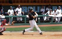 Towson's Kurt Wertz hits an RBI double in the sixth inning of an NCAA regional tournament college baseball game against Florida Atlantic in Chapel Hill, N.C., Friday, May 31, 2013. Towson won 7-2. (AP Photo/Ted Richardson)