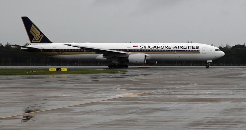 A Singapore Airlines Boeing 777 aircraft taxis on a runway at Changi airport in Singapore