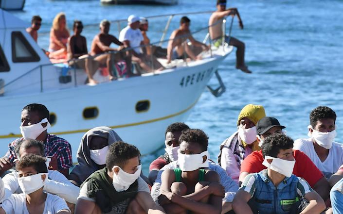 The mayor of Lampedusa says the tiny island cannot handle the migrant arrivals - AFP