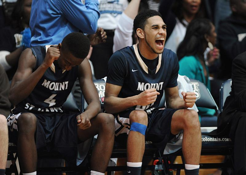 Mount St. Mary's' Khalid Nwandu (4) and Julian Norfleet (23) celebrate on the bench during the second half of the Northeastern Conference championship NCAA college basketball game against Robert Morris on Tuesday, March 11, 2014, in Coraopolis, PA. Mt. Saint Mary won 88-71.(AP Photo/Don Wright)