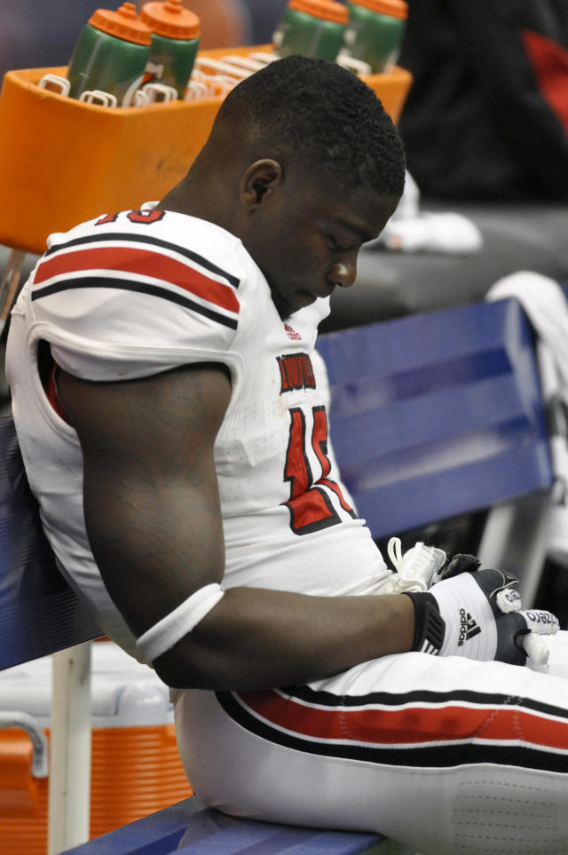 Louisville's Andrew Johnson reacts after his team lost 45-26 to Syracuse 45-26 in an NCAA college football game in Syracuse, N.Y., Saturday, Nov. 10, 2012. (AP Photo/Kevin Rivoli)