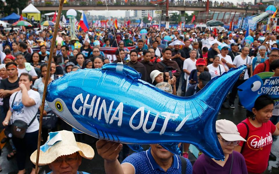 The protesters display a balloon with an anti-China message during a rally near the Philippine Congress in Manila, Philippines - AP