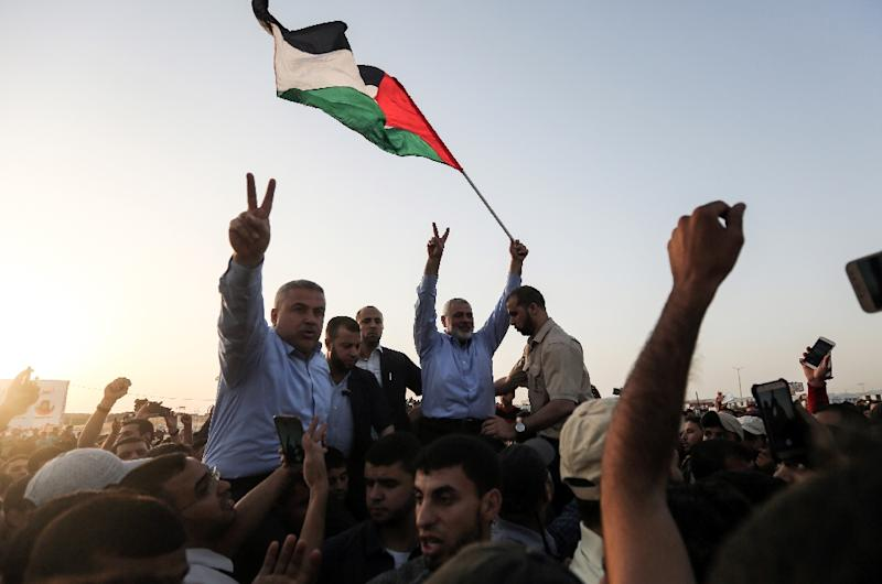 Ismail Haniya, the head of the Palestinian Islamist movement Hamas, gestures to demonstrators at a protest along the border with the Gaza Strip on May 18, 2018