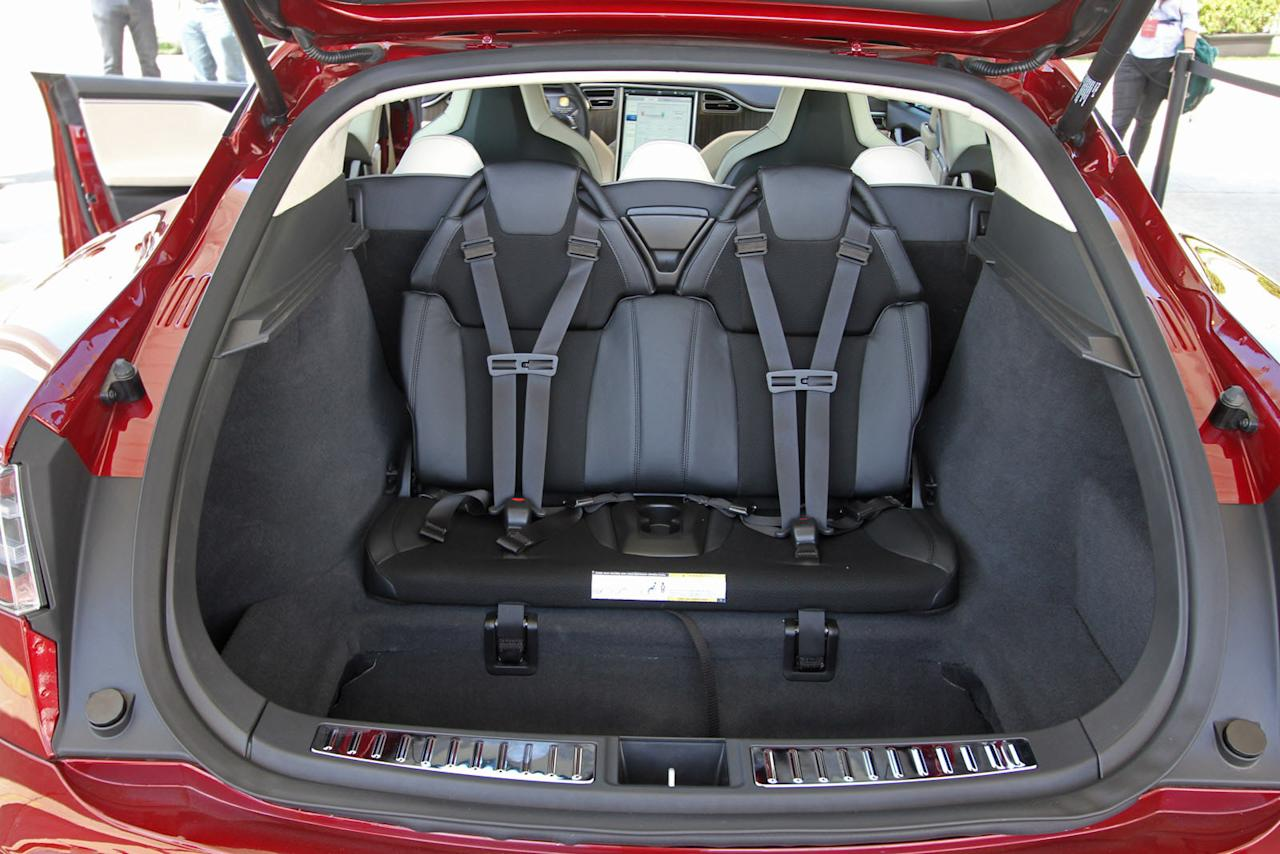 The rear-facing seats in the trunk area of the Tesla Model S.