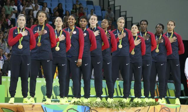 2016 Rio Olympics - Basketball - Final - Women's Gold Medal Game USA v Spain - Carioca Arena 1 - Rio de Janeiro, Brazil - 20/8/2016. United States players stand for the playing of the U.S. National Anthem during the medal presentation ceremony for the women's basketball top finishers. REUTERS/Shannon Stapleton FOR EDITORIAL USE ONLY. NOT FOR SALE FOR MARKETING OR ADVERTISING CAMPAIGNS.