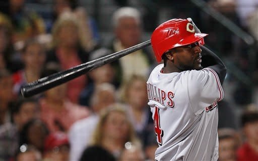 Cincinnati Reds' Brandon Phillips watches his RBI double in the eighth inning of a baseball game against the Atlanta Braves, Monday, May 14, 2012, in Atlanta. (AP Photo/John Bazemore)