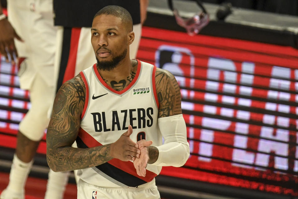 Damian Lillard rubs his hands together during a Trail Blazers game.