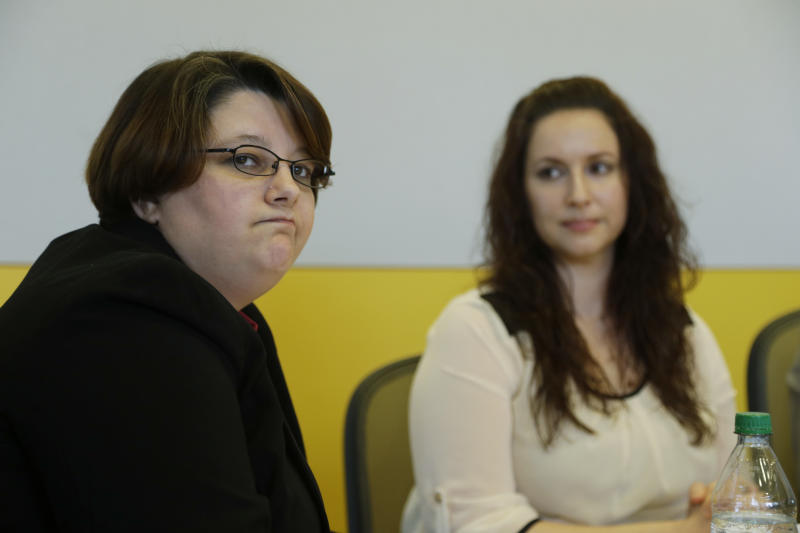 Angela Arellano, left, formerly of the U.S. Marines, and Nichole Bowen, right, formerly of the U.S. Army, talk to reporters, Friday, May 31, 2013 in Seattle about the issue of sexual assault in the military. Both women identified themselves as being survivors of sexual assault during their time in military service and the were appearing with U.S. Sen. Patty Murray, D-Wash., who has introduced the Combating Military Sexual Assault (MSA) Act of 2013, which aims to reduce sexual assaults within the military and strengthen current law and policies. (AP Photo/Ted S. Warren)