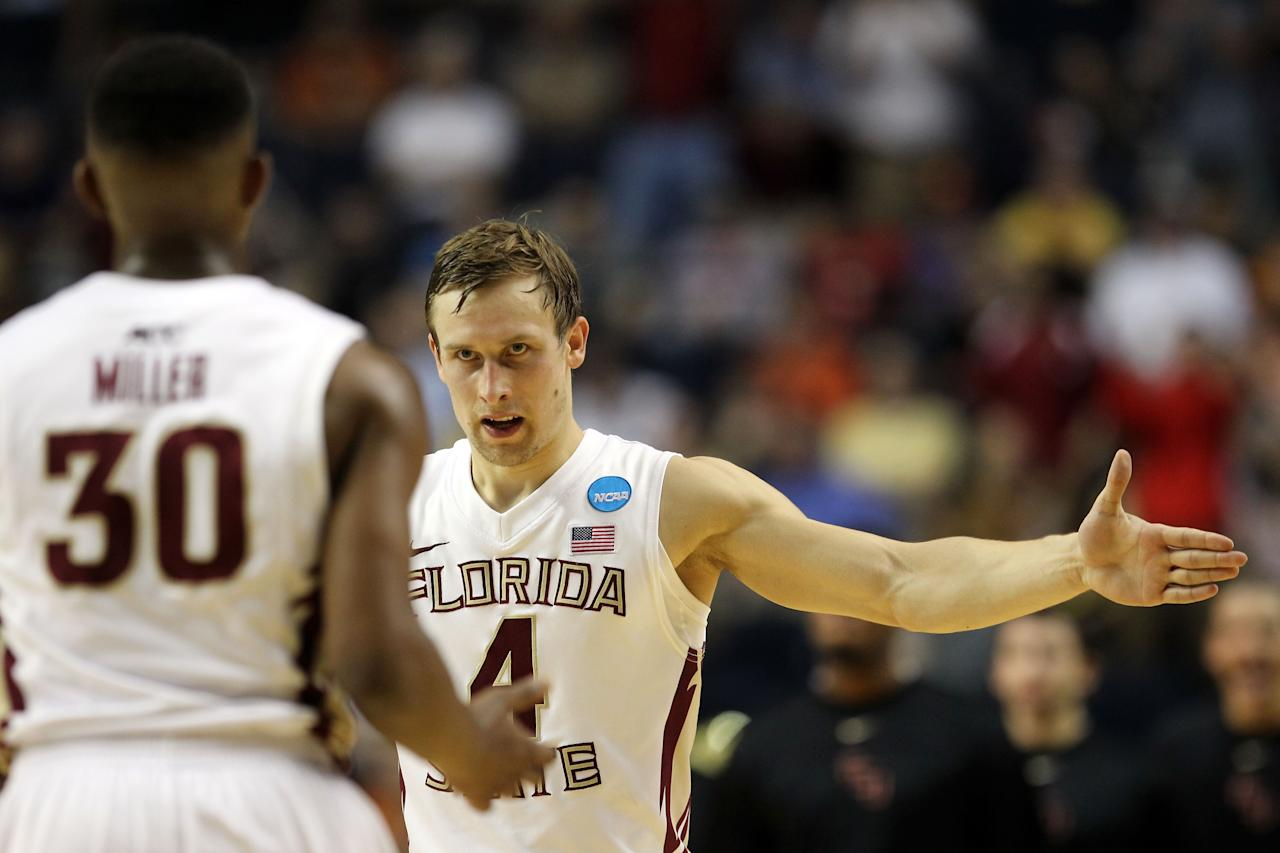 NASHVILLE, TN - MARCH 16:  Deividas Dulkys #4 of the Florida State Seminoles high-fives Ian Miller #30 after a play against the St. Bonaventure Bonnies during the second round of the 2012 NCAA Men's Basketball Tournament at Bridgestone Arena on March 16, 2012 in Nashville, Tennessee.  (Photo by Jamie Squire/Getty Images)