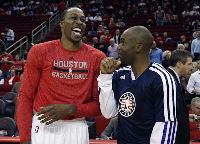 Houston Rockets' Dwight Howard, left, laughs as he talks with Los Angeles Lakers' Jodie Meeks, right, before an NBA basketball game Thursday, Nov. 7, 2013, in Houston. (AP Photo/David J. Phillip)