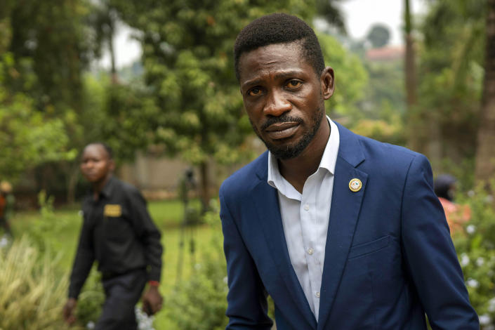 Uganda's leading opposition challenger Bobi Wine walks back to his residence after giving a press conference outside Kampala, Uganda, Friday,Jan. 15, 2021, one day after Ugandans went to the polls. Uganda's electoral commission says President Yoweri Museveni leads in Thursday's election with results in from 29% of polling stations. He has 63% of ballots while top opposition candidate Bobi Wine has 28%. Wine, a popular singer-turned-lawmaker half the president's age, alleges that the vote in the East African country was rigged. (AP Photo/Jerome Delay)