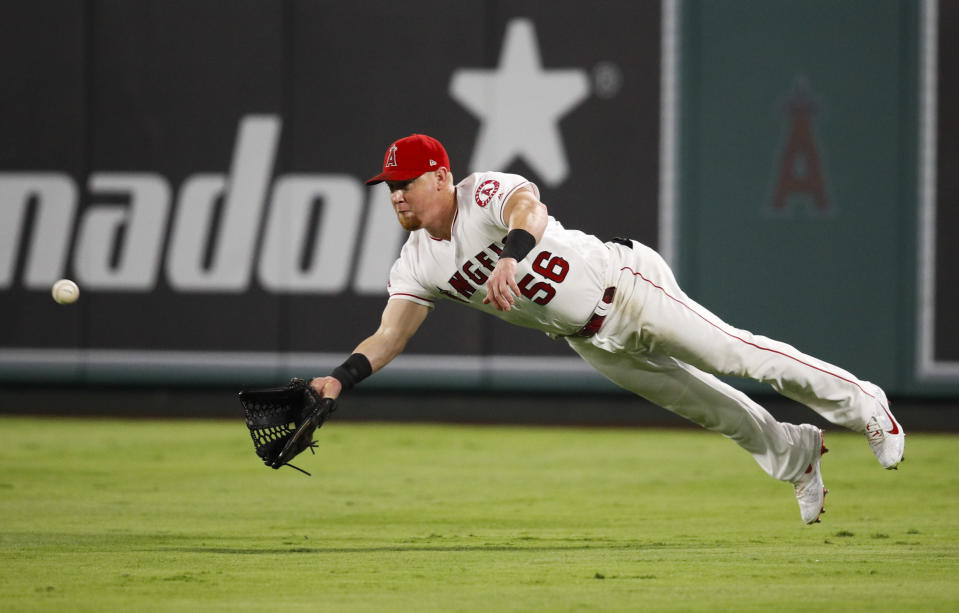 Los Angeles Angels' Kole Calhoun dives to catch a ball hit by Seattle Mariners' Dee Gordon during the eighth inning of a baseball game, Saturday, Sept. 15, 2018, in Anaheim, Calif. (AP Photo/Jae C. Hong)