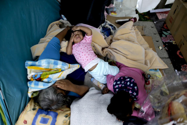 <p>A family sleeps on a square after being displaced from their home due to the risk of collapse, in the aftermath of a 7.1 earthquake, in Mexico City, Friday, Sept. 22, 2017. (Photo: Natacha Pisarenko/AP) </p>