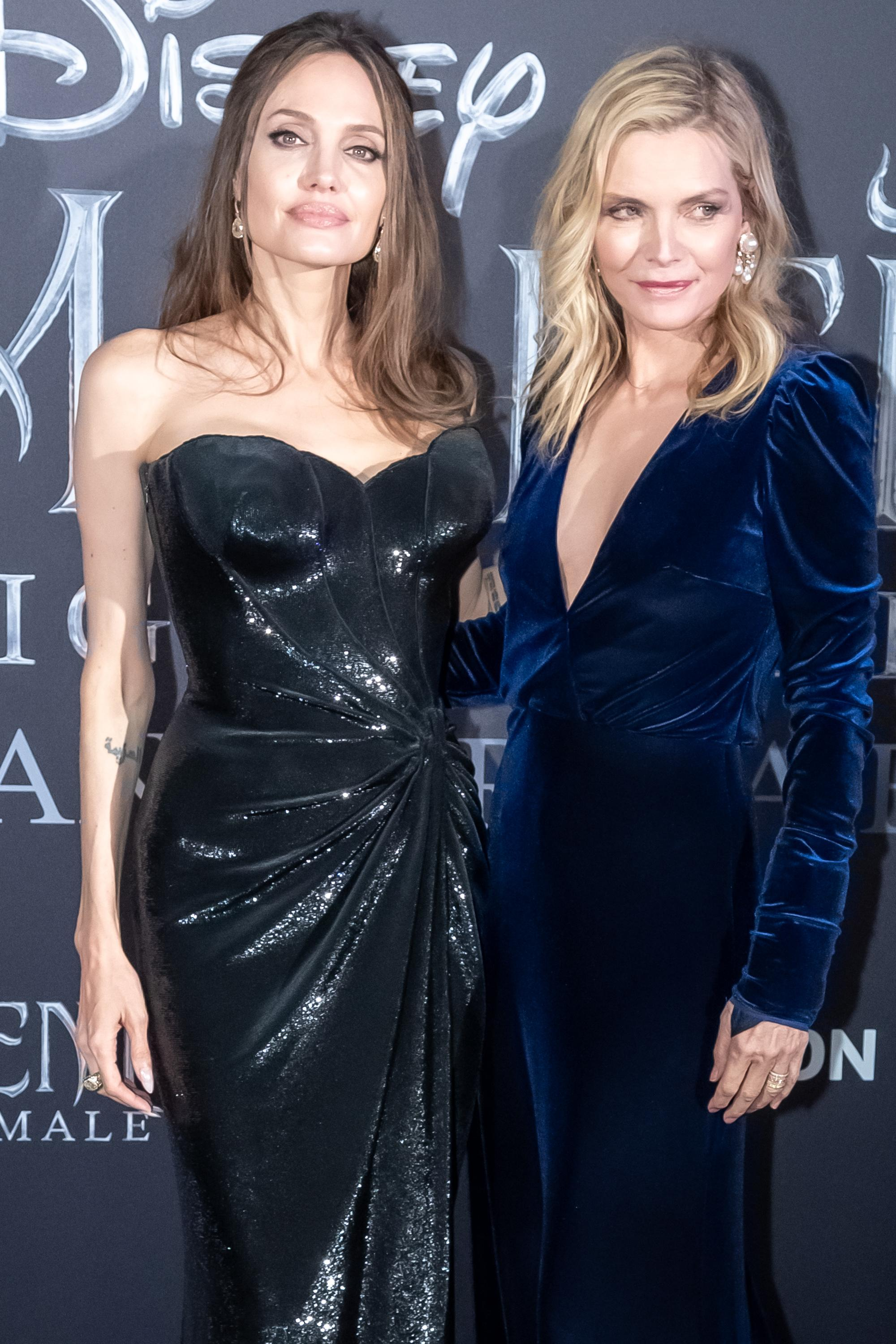 Angelina Jolie and Michelle Pfeiffer both opted for block colour gowns at the premiere in Rome, Italy [Photo: Getty]