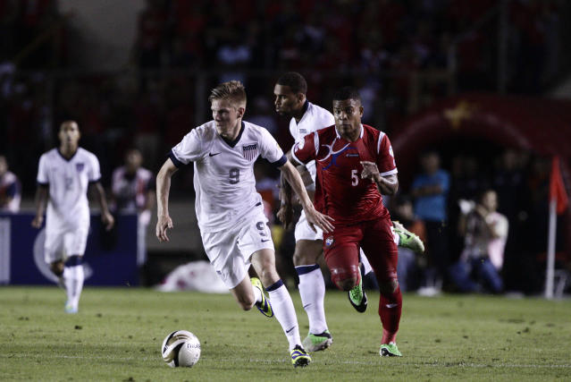Aron Johannsson drives the ball as Panama's Roman Torres follows during a 2014 World Cup qualifying soccer match in Panama City, Tuesday, Oct. 15, 2013. (AP Photo/Arnulfo Franco)