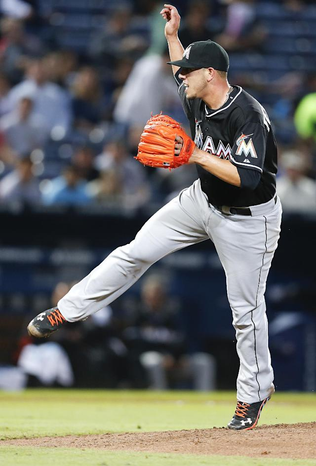 Miami Marlins starting pitcher Jose Fernandez (16) works in the fifth inning of a baseball game against the Atlanta Braves Tuesday, April 22, 2014 in Atlanta. (AP Photo/John Bazemore)