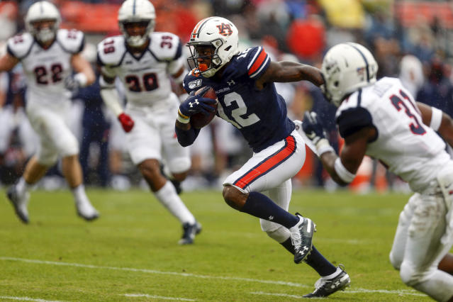 Auburn wide receiver Eli Stove (12) carries the ball during the first half of an NCAA college football game against Samford, Saturday, Nov. 23, 2019, in Auburn, Ala. (AP Photo/Butch Dill)